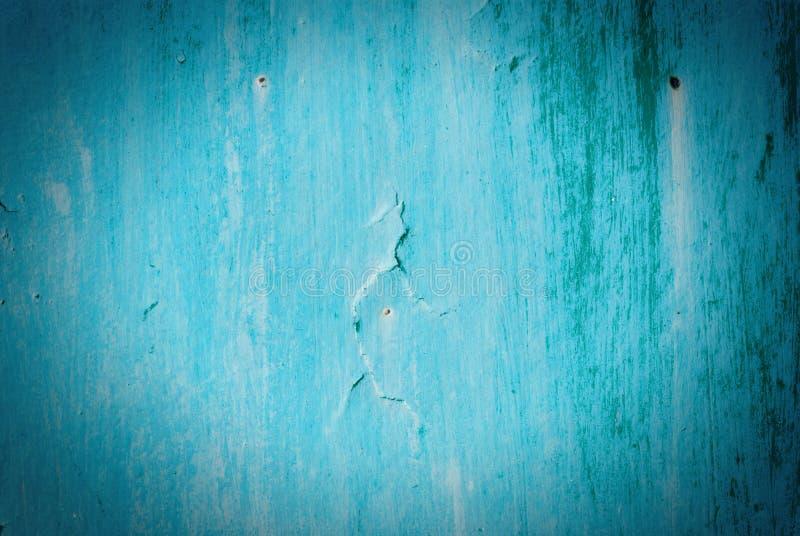 Oude gebarsten geschilderde textuur. Roestig blauw hout. stock fotografie