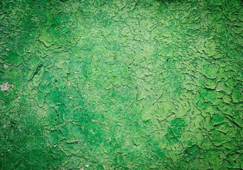 Oude gebarsten geschilderde textuur. Roestig groen hout. stock foto's