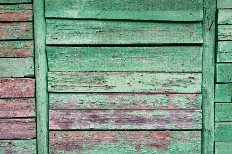 Oude geschilderde muur van houten planken stock afbeelding