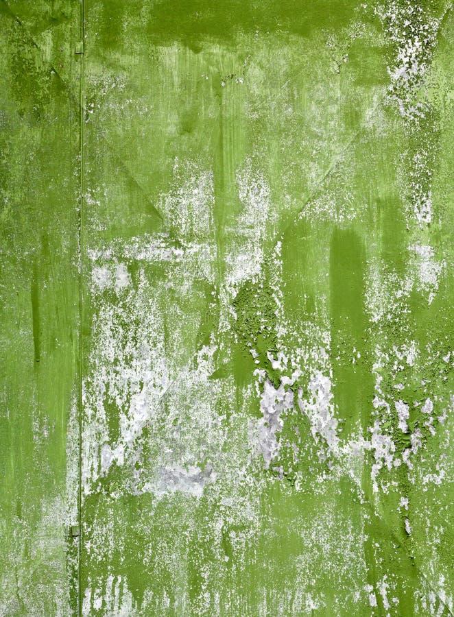 Oude groene geschilderde staalplaattextuur als achtergrond royalty-vrije stock afbeeldingen