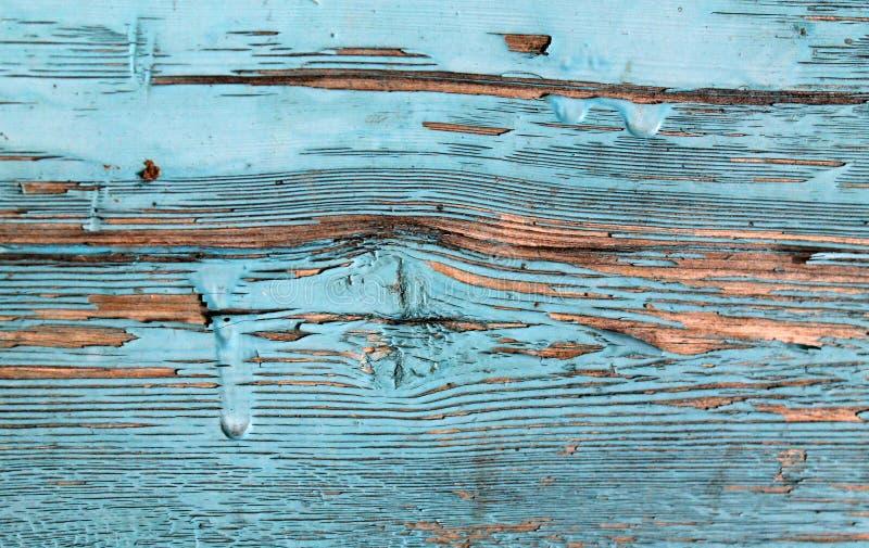 Oude houten achtergrond met overblijfselen van stukken schroot van oude verf op hout Textuur van een oude boom, raad met verf, ui royalty-vrije stock foto