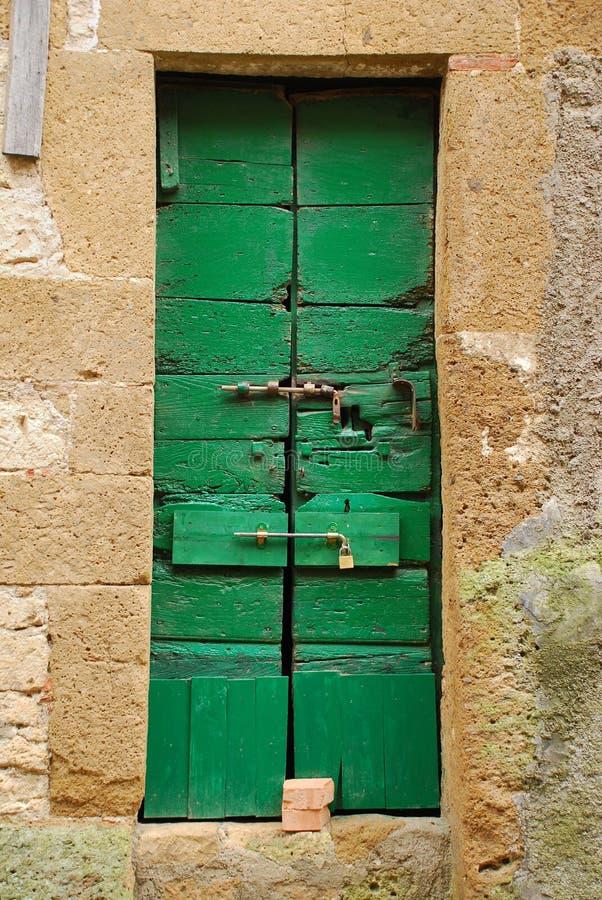 Oude Houten Deur in Toscanië 7 stock foto's