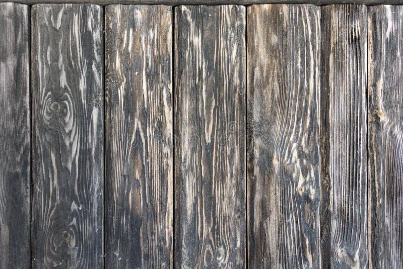 Oude houten donkere achtergrond die uit sjofele zwart-bruine geweven raad bestaan stock foto's