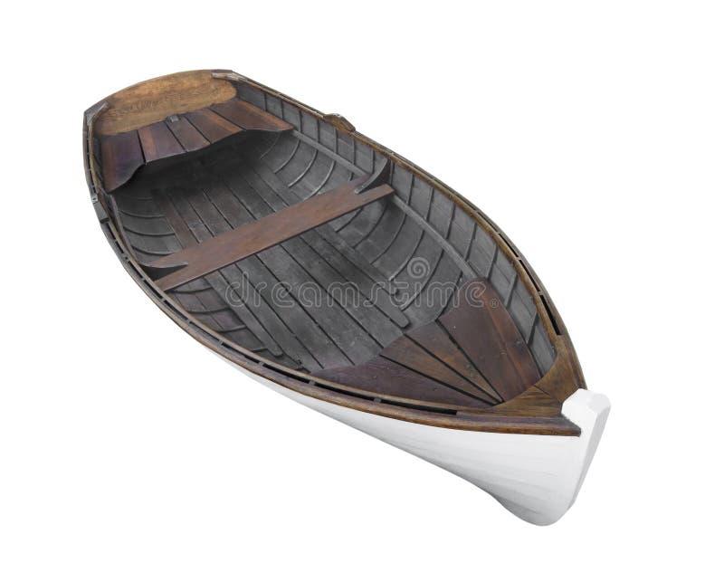 Oude houten geïsoleerde roeiboot stock afbeeldingen