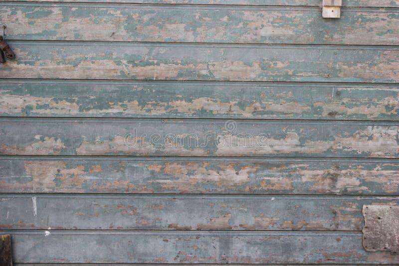 Oude houten muur, met behoefte aan verf stock foto