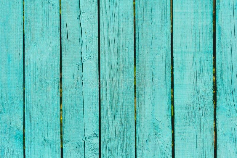 Oude houten omheining van planken geschilderde turkooise achtergrond, tekst stock afbeelding