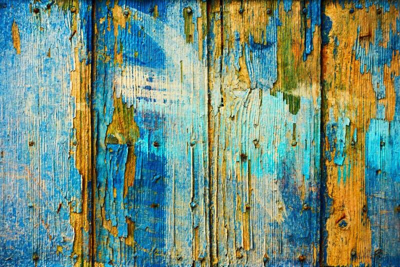 Oude houten raad met afschilferende blauwe verf stock afbeelding