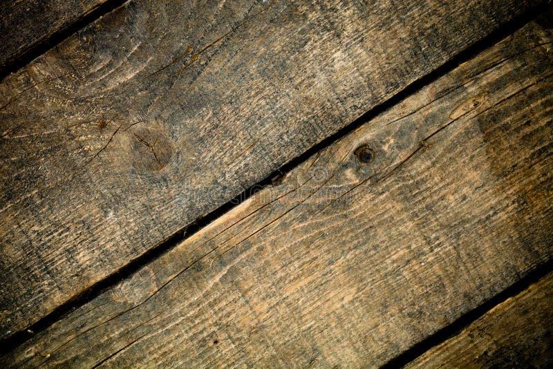 Oude houten rustieke textuur voor achtergrond Ruwe doorstane houten raad gestemd stock foto