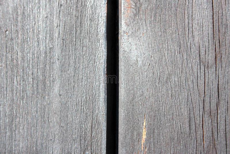 Oude, houten textuur, met spleet in het midden en de aders van het hout zelf royalty-vrije stock foto's