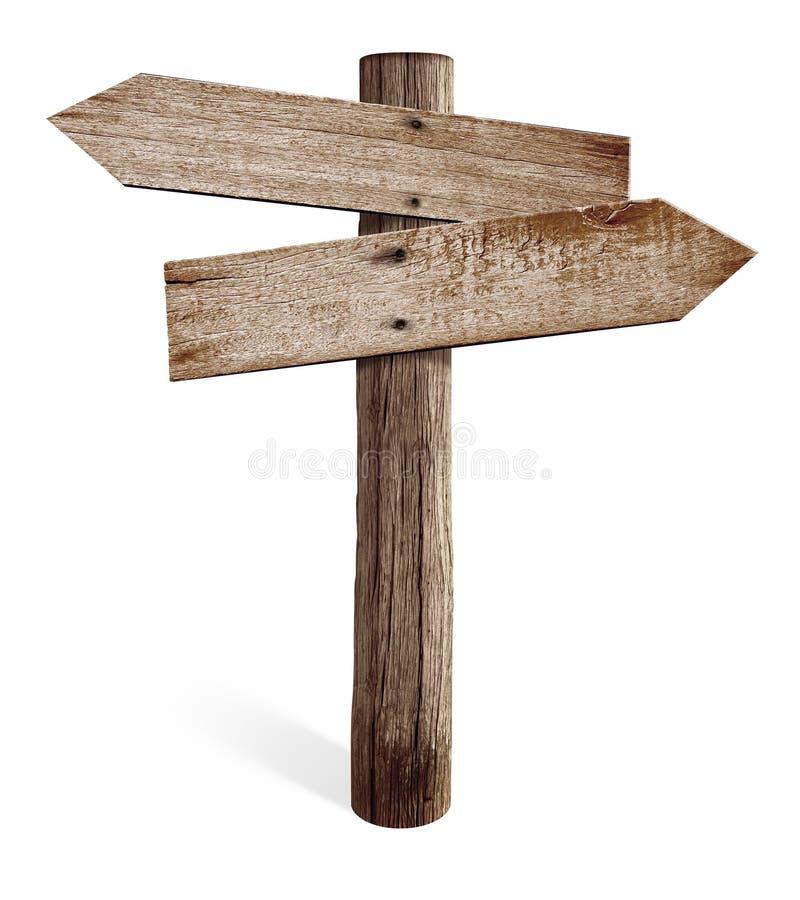 Oude houten verkeersteken met linker en juiste pijlen stock afbeeldingen