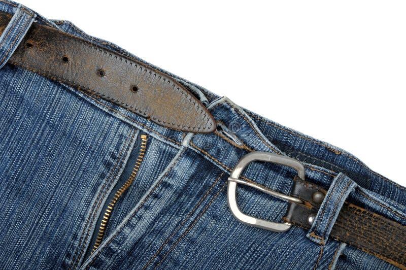 Oude jeans en een riem stock afbeeldingen