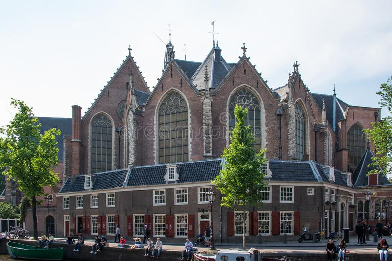 Oude Kerk Old church and civilians in Amsterdam royalty free stock images