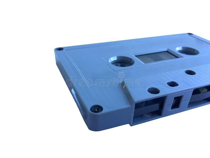 Oude klassieke grijze die bandcassette op filmbekleding op witte achtergrond wordt geïsoleerd stock foto's