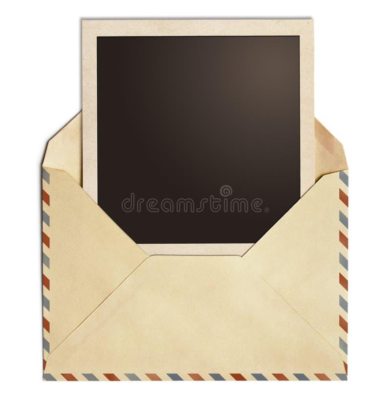 Oude lucht postenvelop met geïsoleerde het kader van de polaroidfoto royalty-vrije stock foto's