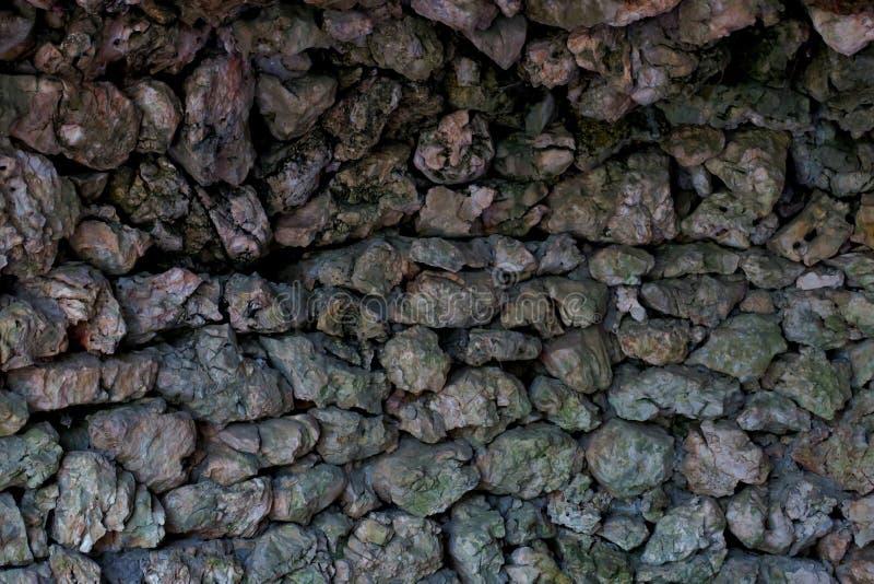 Oude mooie die muur van stenen prachtige achtergrond wordt gemaakt stock afbeelding