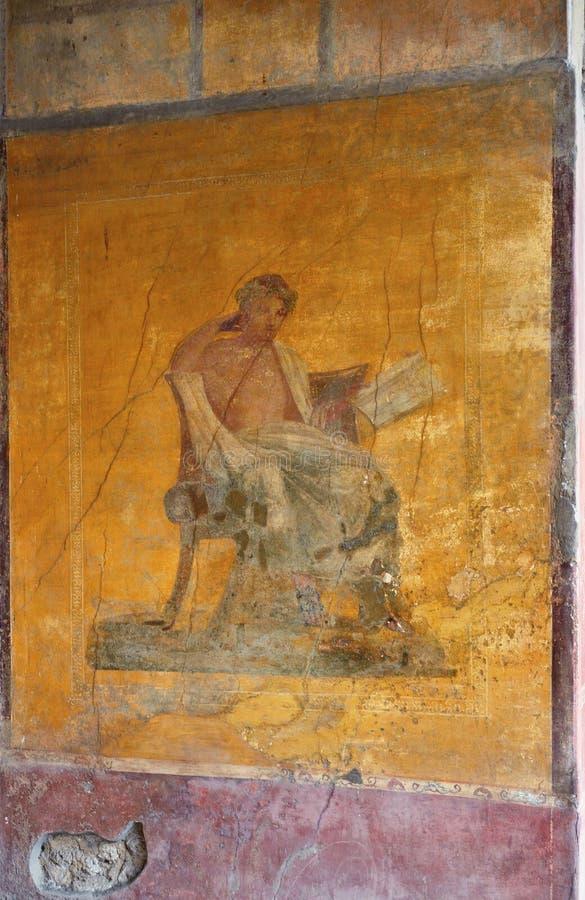 Oude muur met een extant muurschildering stock fotografie