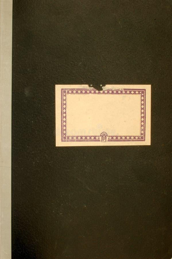 Oude notitieboekjedekking stock foto