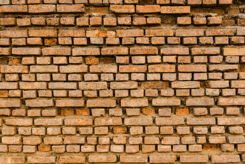 Oude Oude Uitstekende Grunge Dusty Orange Brick Wall With Één of andere Cra royalty-vrije stock afbeeldingen
