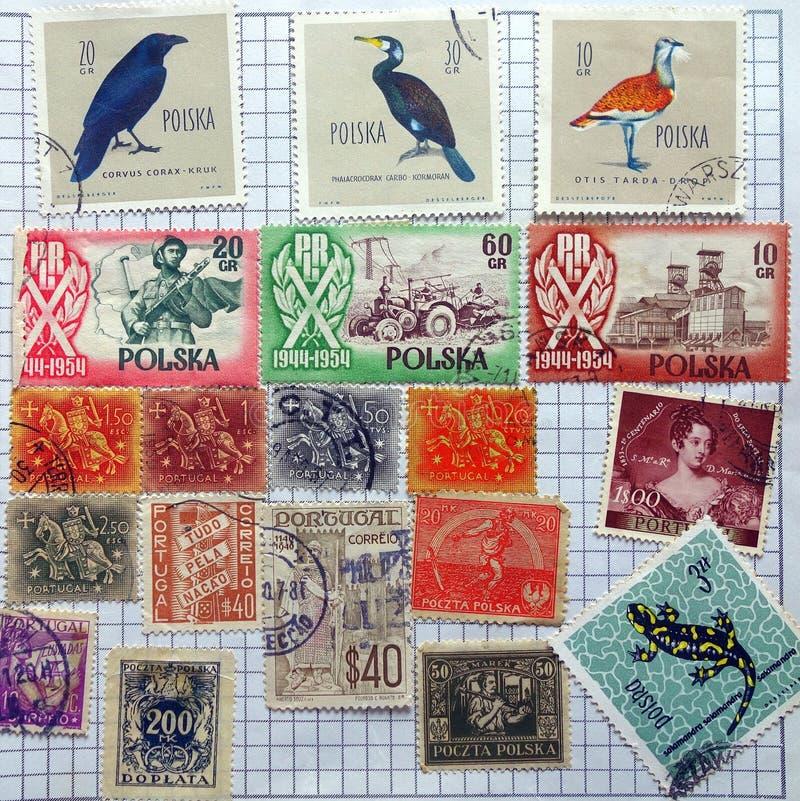 Oude Postzegels, Polen en Portugal royalty-vrije stock afbeelding