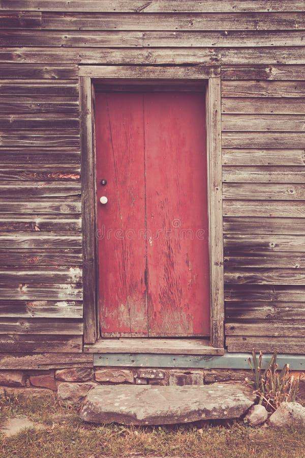 Oude rode deur stock foto