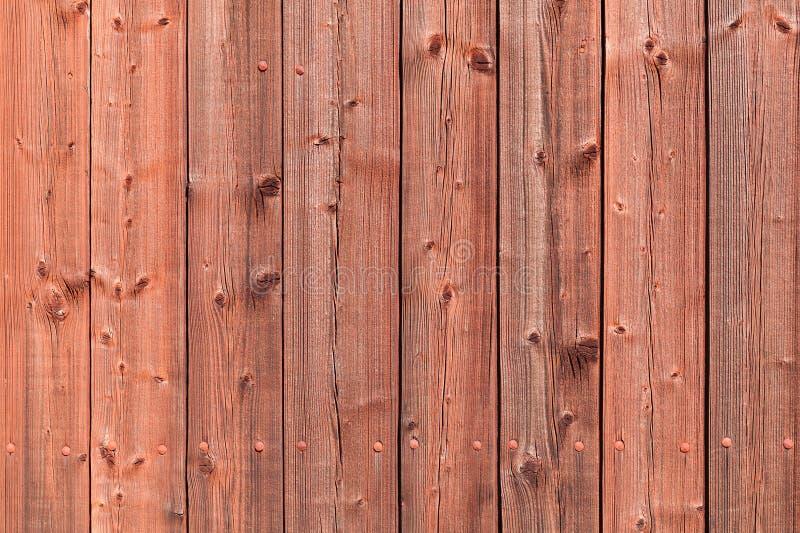 Oude rode landelijke houten muur, gedetailleerde foto als achtergrond royalty-vrije stock foto's