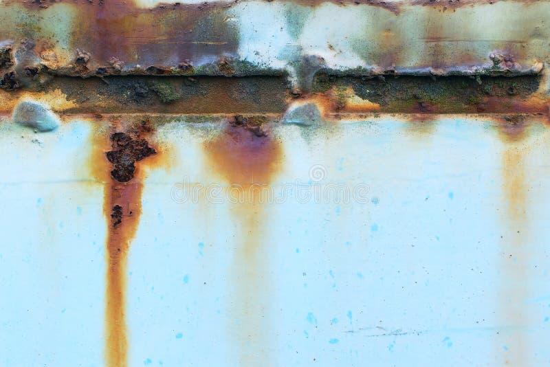 Oude roestige gekleurde metaalachtergrond stock afbeelding
