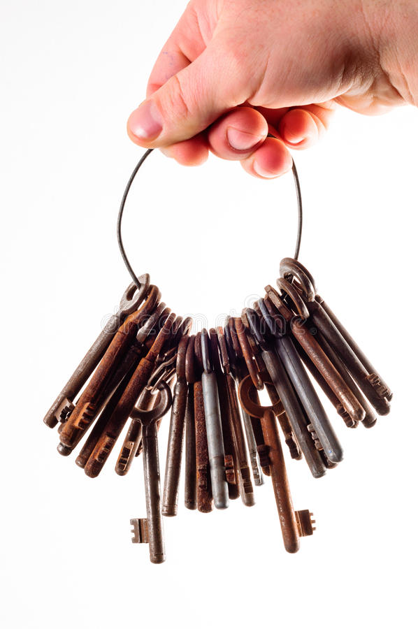 Oude roestige sleutels op wit stock foto's