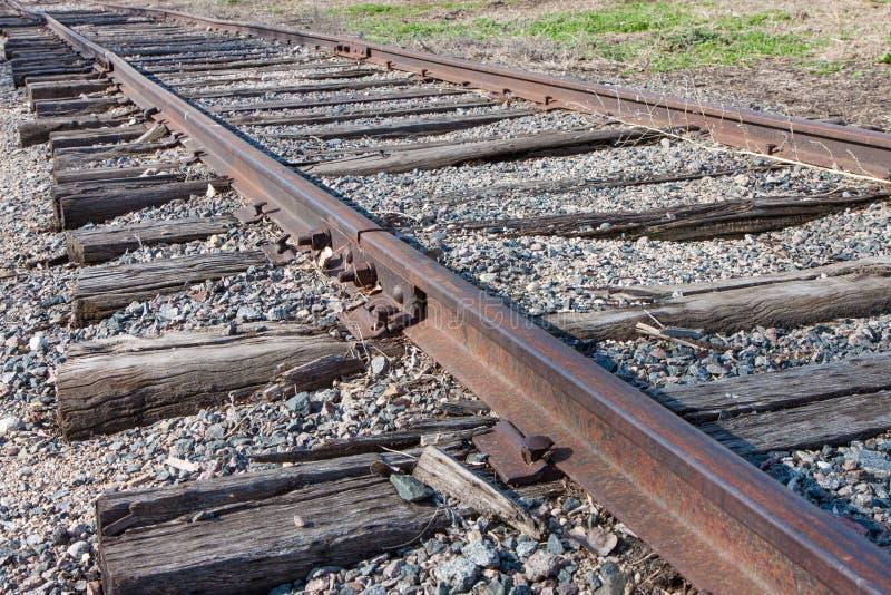 Oude roestige spoorwegsporen stock foto