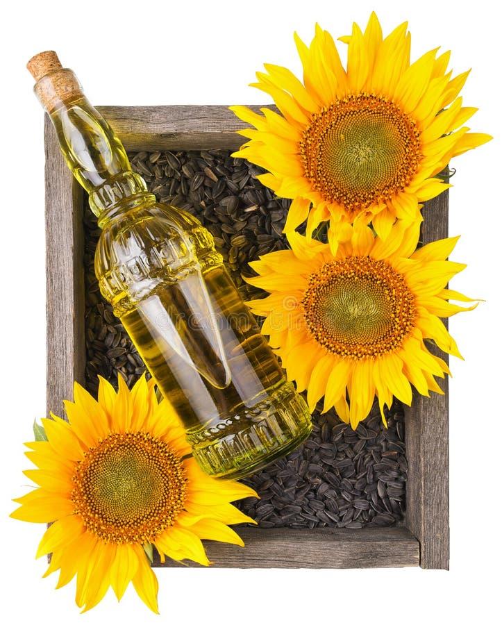 Oude ruwe houten doos met zonnebloemen, oliefles royalty-vrije stock foto