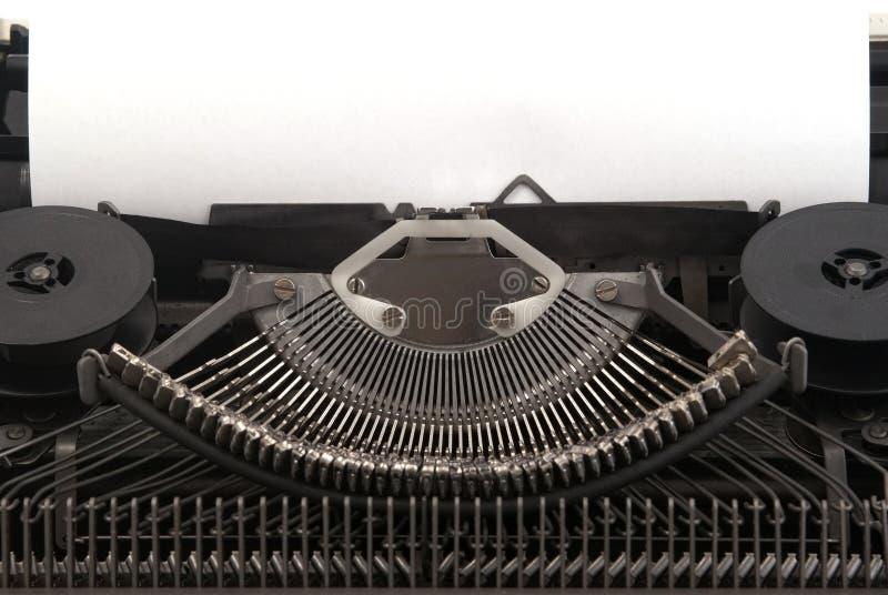 Oude Schrijfmachine met leeg blad van document royalty-vrije stock fotografie
