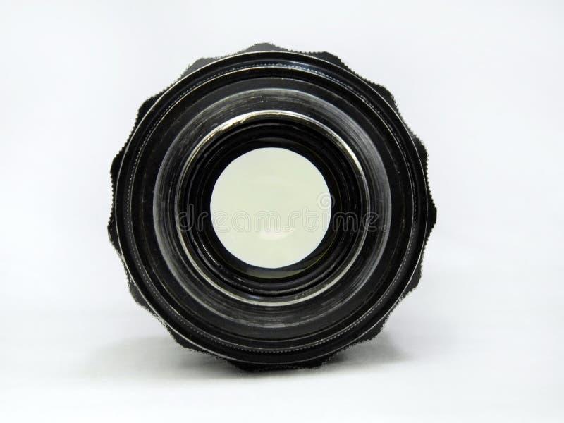 Oude sjofele lens achtermening stock foto
