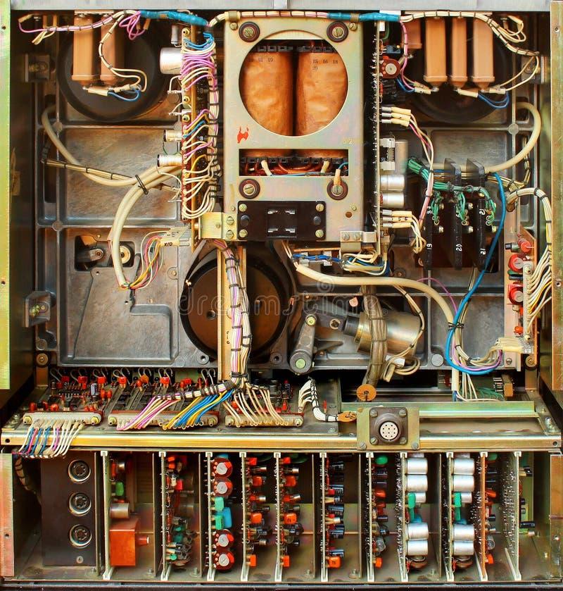 Oude sovjet het registreertoesteldarmen van de bandspoel Retro elektronische delen en mechanismen stock afbeeldingen