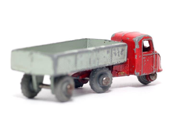 Oude stuk speelgoed auto mechanische paard en aanhangwagen stock afbeeldingen