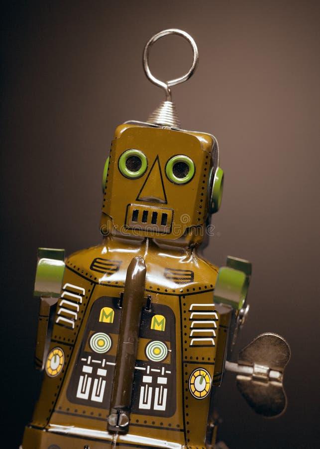 Oude stuk speelgoed robot stock foto's