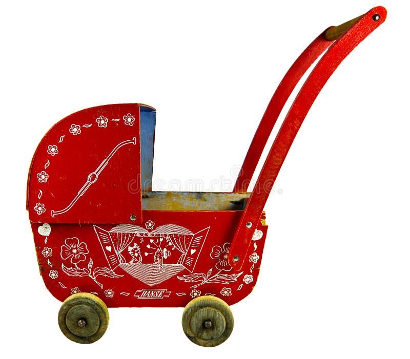 Oude stuk speelgoed wandelwagen royalty-vrije stock afbeeldingen