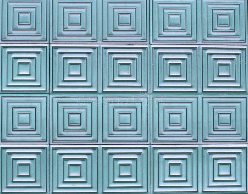 Oude tegels op de muur met een uniek vierkant patroon royalty-vrije stock afbeelding