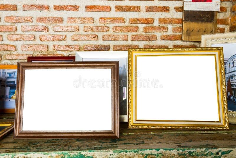 oude twee fotokaders op de houten lijst royalty-vrije stock fotografie