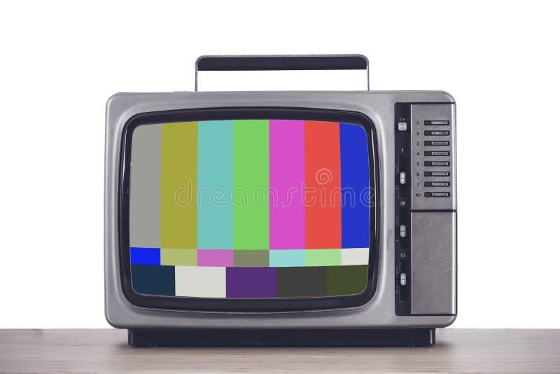 Oude uitstekende TV met glitch het scherm stock foto