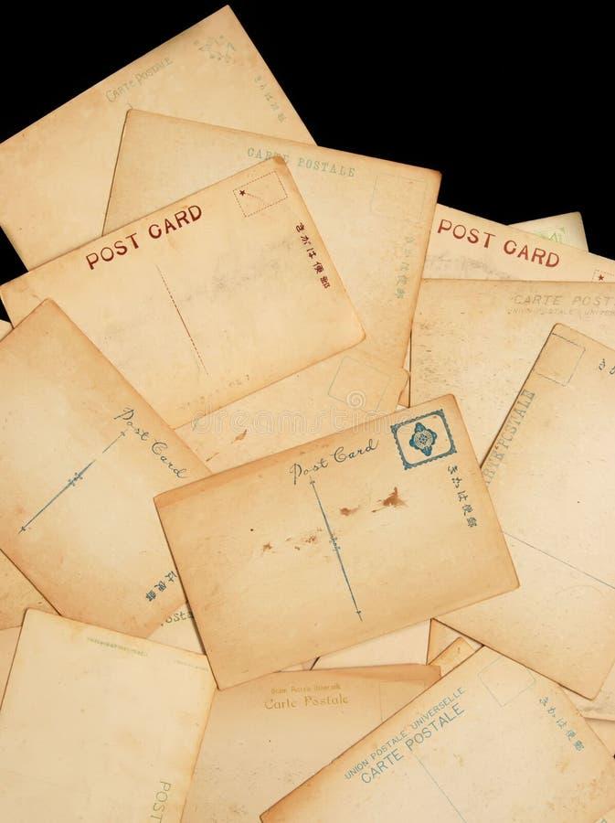 Oude versleten prentbriefkaaren stock afbeeldingen