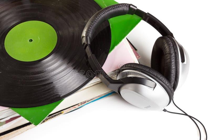 Oude vinyl en hoofdtelefoons royalty-vrije stock foto