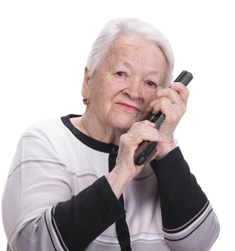 Oude vrouw met pistool royalty-vrije stock foto's