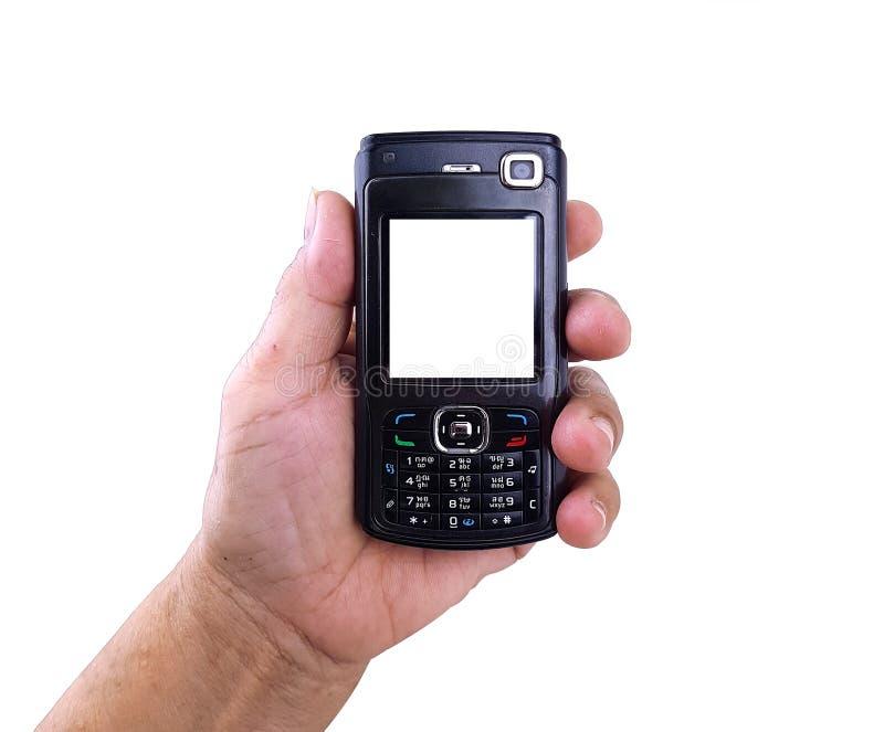 Oude vrouwelijke hand met een oude zwarte mobiele telefoon stock afbeeldingen