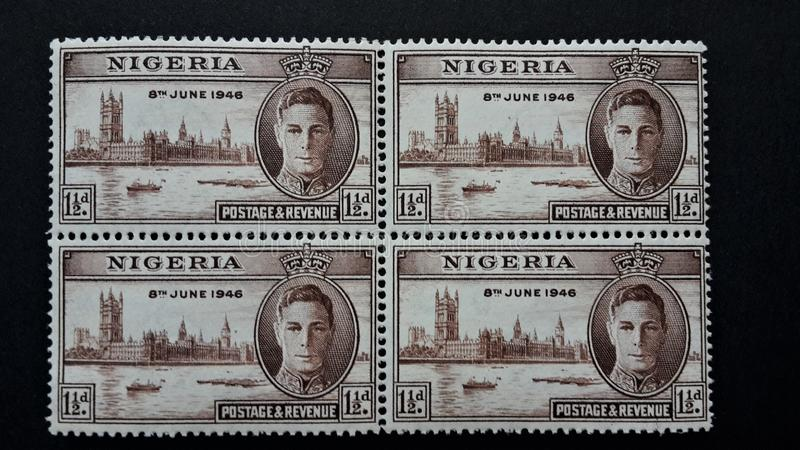 Oude zegels van Nigeria vier samen in entrepot 1,5d stock afbeelding