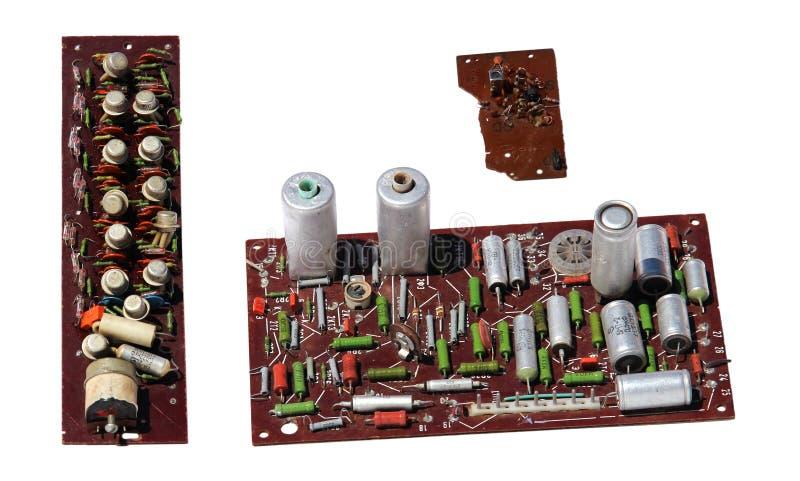 Oude zeldzaamheidsradio, TV-raad met elektronische componenten, gedrukt c stock foto's