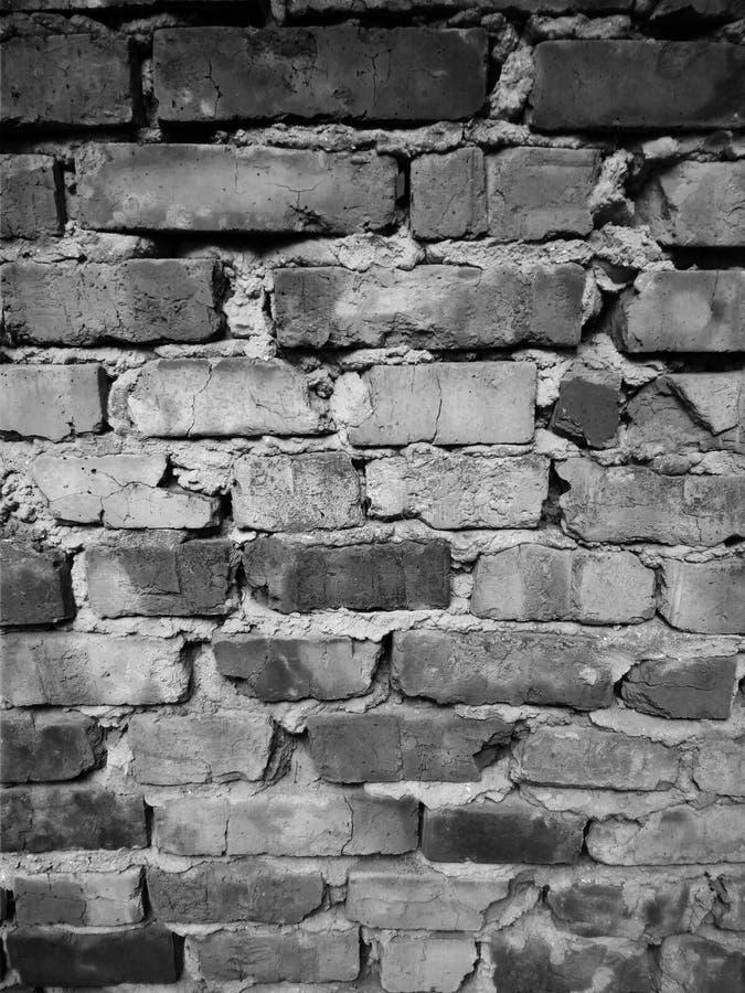 Oude zwart-witte bakstenen muur stock foto