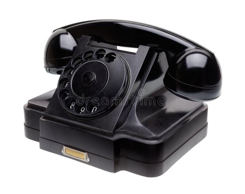 Oude zwarte telefoon stock foto