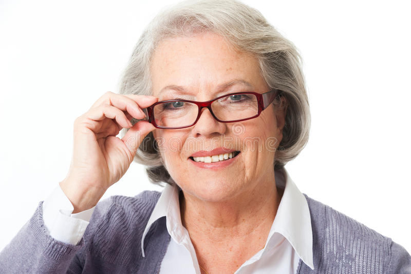 Oudere vrouw met glazen royalty-vrije stock foto