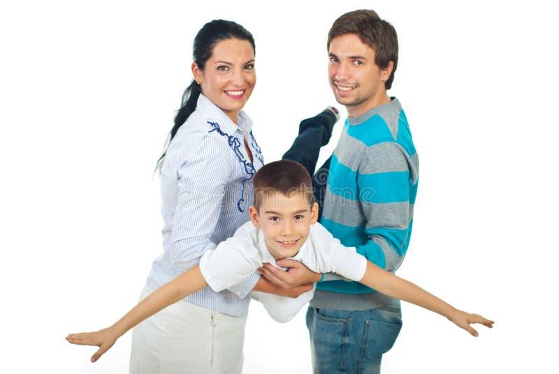 Ouders die met hun kind spelen stock foto's