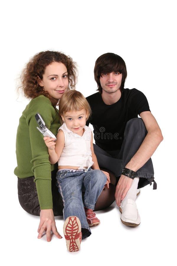Ouders en dochter met celtelefoon stock afbeeldingen