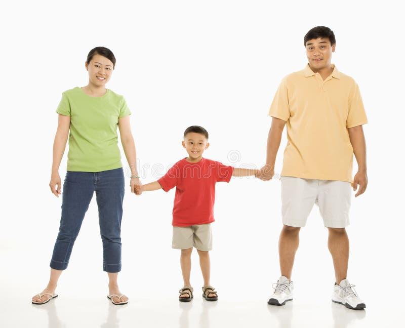 Ouders met zoon. stock afbeeldingen